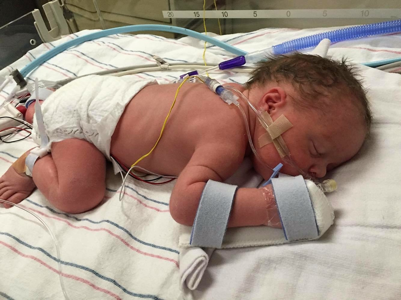 newborn in hospital bed